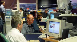 Journalists at work in the BBC News Online production centre in London