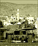 An Israeli Defense Force tank on a hill overlooking Jenin