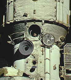 Valery Polyakov, who spent 438 days in space, peers out of a Mir window