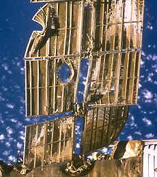 A close-up view of a damaged radiator panel on Mir's Spektr module