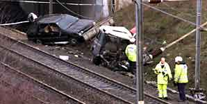 A car crashed down an embankment onto the East Coast Main Line