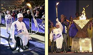 Torch bearer Chris Waddell starts the celebrations by lighting the Olympic cauldron