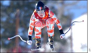 Carole Montillet of France takes to the air on the way to the downhill gold