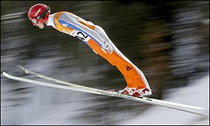 Switzerland's Simon Ammann flies through the air on the way to a gold medal