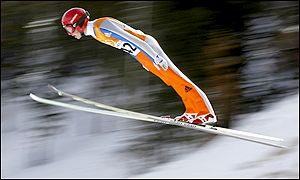 Simon Ammann on his way to the gold medal in the men's K120 ski jumping