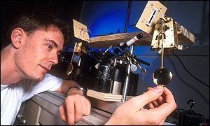 Researcher Matthew Bennett adjusts one of the clocks, Georgia Tech Photo - Gary Meek
