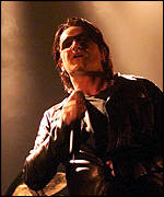Bono performing in London in 2001