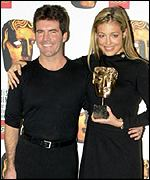 Simon Cowell with Cat Deeley at the Baftas