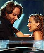 Russell Crowe greets Kylie Minogue