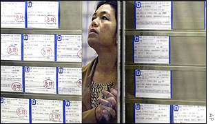 Woman checks employment bureau window