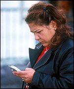 Turkish woman uses a mobile phone