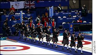 Pipers herald the British team's entrance