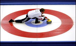 Paal Trulsen of Norway competes in the men's curling gold medal match between Canada and Norway