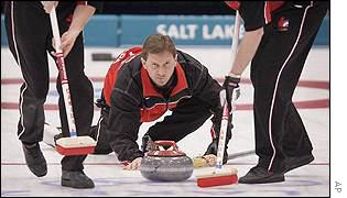 Don Bartlett of Canada competes against Norway during the men's curling final