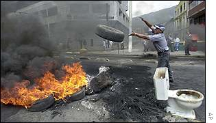Protestor burning a tyre