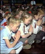 Children praying for the victims of the 1989 Hillsborough football tragedy