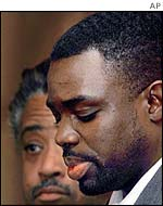 Abner Louima seen at the 1999 trail of the police officers, with Reverend Al Sharpton beside him