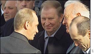 Russian President Vladimir Putin, left, greets Georgian President Eduard Shevardnadze, 2nd right