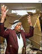 Mohammed Houti, 70, looks at damage caused by Israeli troops to his house in Balata camp
