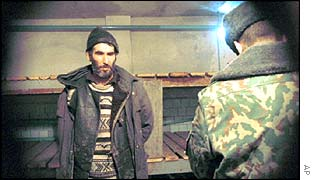 A man is interrogated in a filtration camp in the Chechen village of Chernokozovo, northwest of Groznyy. Allegations of torture at the camp were denied.