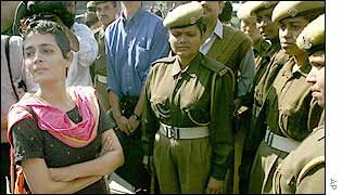 Arundhati Roy with police