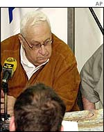 Ariel Sharon examines a military map