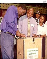 Officials demonstrate how ballot boxes will be sealed for the 2002 presidential election