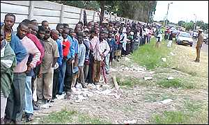 Voters queue to vote in Harare