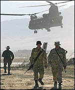 US soldiers and helicopter at Bagram airbase