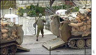 Israeli soldier takes part in a house raid in Ramallah