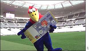 Mascot Footix holds a replica of a ticket for the World Cup in Paris in 1998.