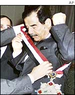 Iraqi President Saddam Hussein receives a Kurdish honour