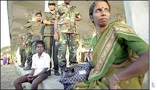 Government soldiers with Tamil civilians in northern Jaffna