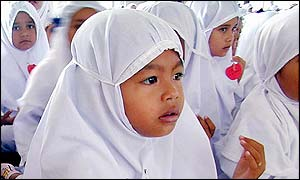 Acehnese children pray together at Baiturrahim mosque in Banda Aceh, 13 March 2002