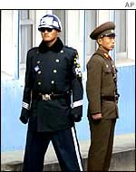 South Korean solider (l) and North Korean soldier (r) on the Korean border