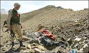 US soldier looks over a bombed out al-Qaeda position