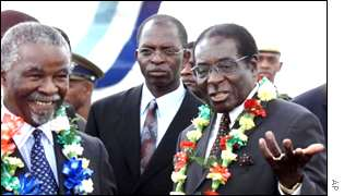 Thabo Mbeki (left) and Robert Mugabe (right)