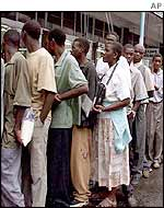 Zimbabweans queue for food in Harare