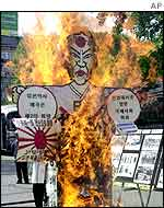 An effigy of Japanese Prime Minister Junichiro Koizumi is burned during an anti-Japan rally, Seoul, May 2001