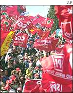 Protesters wave flags at labour rights rally