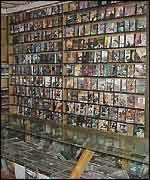 A shop shelf full of porn videos