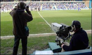 TV cameraman at Gillingham vs Millwall game