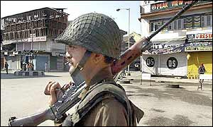 Indian soldier guarding empty Srinagar street
