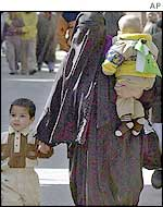 Srinagar woman walks with her children
