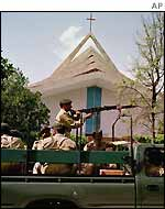 Soldiers guard a Catholic church in Islamabad