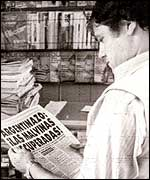 Argentine man reading newspaper