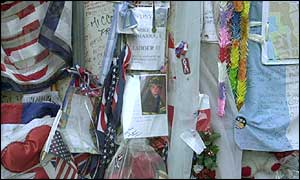 Tributes to World Trade Center victims cover a wall