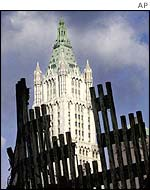 The Woolworth Building rises behind the ruins of the World Trade Center