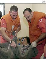 Lebanese Red Cross workers try to help injured Lebanese woman