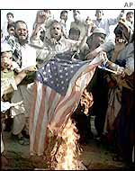 Opponents of President Musharraf's pro-coalition policy burn US flag